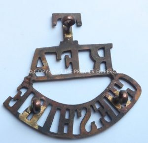 "BRITISH ""T,RFA.CHESHIRE' BRASS GREAT WAR SHOULDER TITLE."