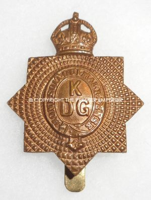 British 1st King's Dragoon Guards cap badge.Economy issue in brass.Circa.1916/1918