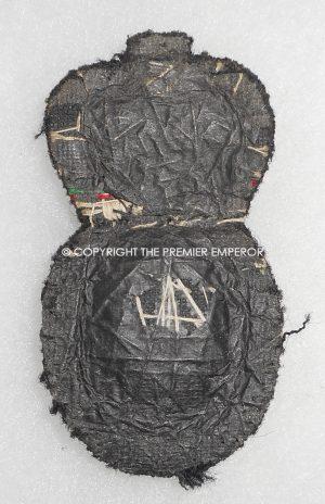 British Her Majesty's Coast Guard cap insignia.