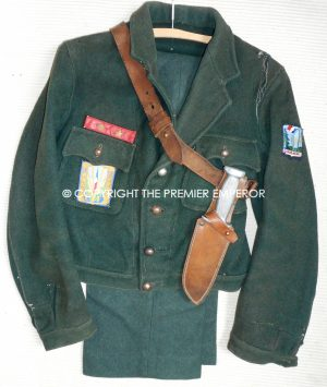 A Scarce French CJF. (Chantiers Jeunesse Francais)21, QUAND MEME Battldress tunic and trousers together with belt and knife..Circa.1940's