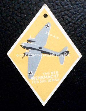 "German Tinnie/Day badge. ""Tag der Wehrmacht fur das W.H.W.(Cardboard)"