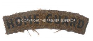 British: Home Guard printed cloth shoulder title(Black on Khaki). Circa.1939/45