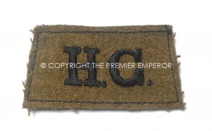 British: Home Guard woven slip-on shoulder title(Black on Khaki). Circa.1939/45